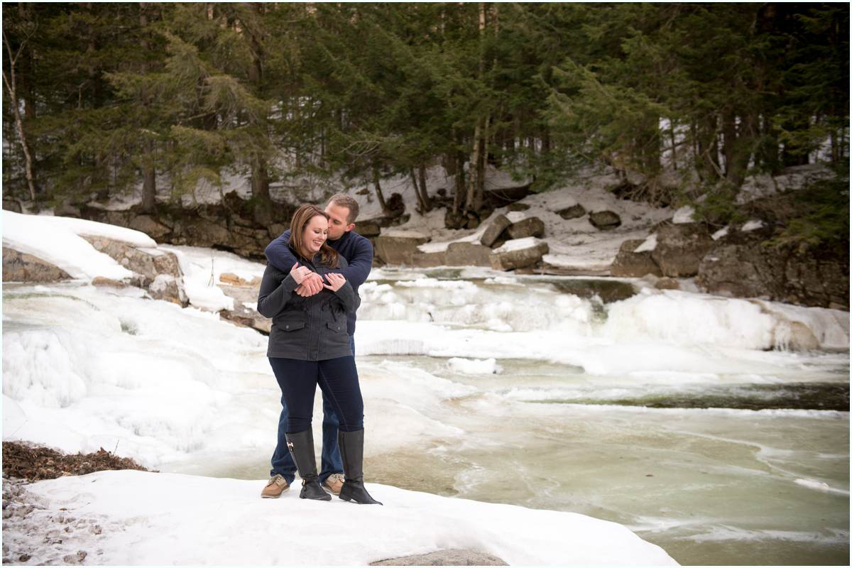 Couple standing in Jackson Falls in New Hampshire
