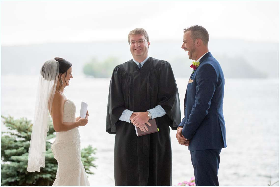 excited couple exchanging vows photos