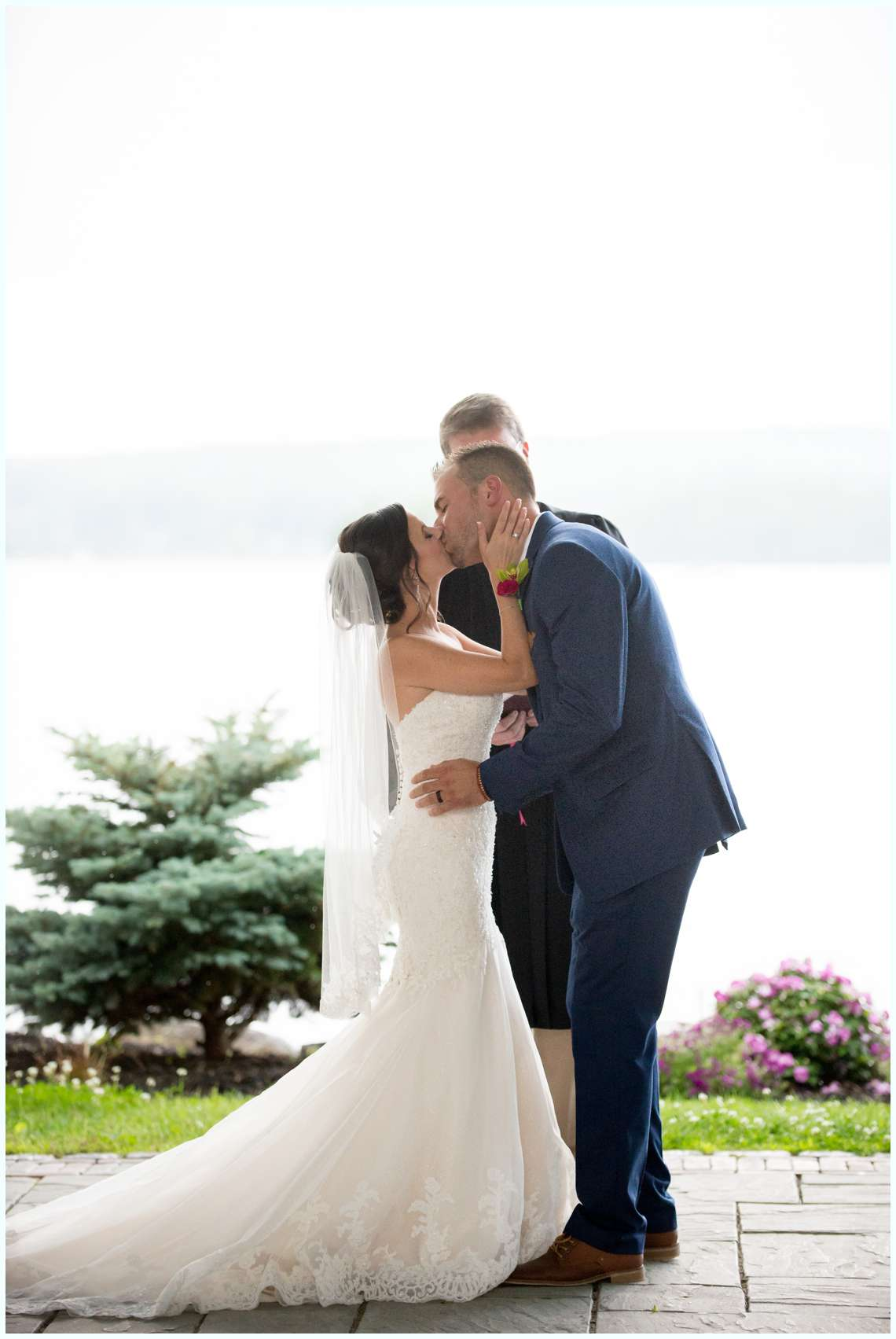 First kiss during wedding ceremony New Hampshire Lakeside