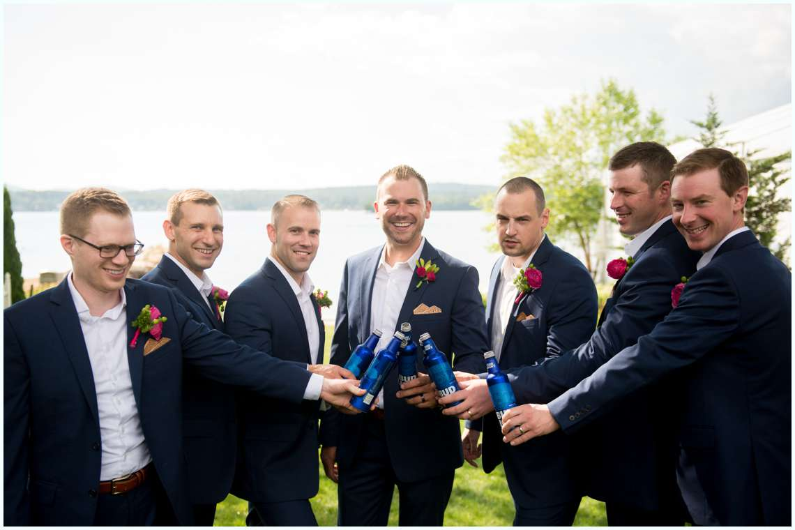Groom with groomsmen drinking on wedding day