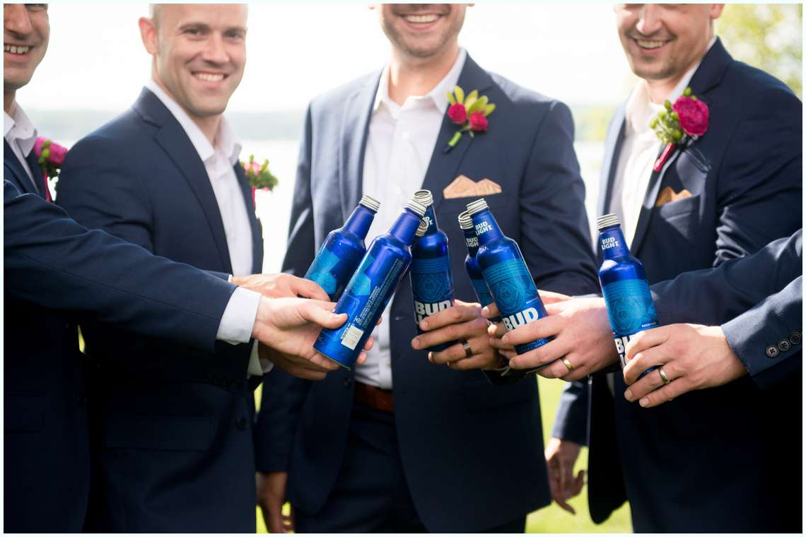 groom and groomsmen in navy blue suits for wedding