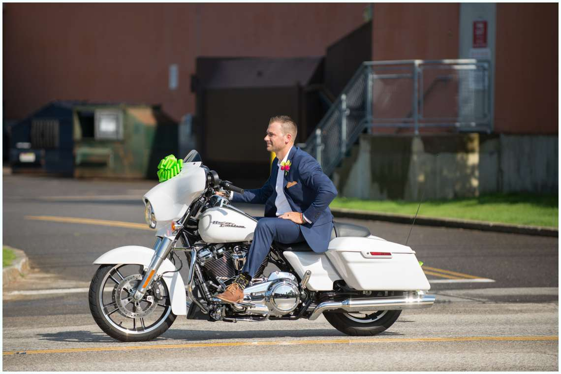 groom riding motorcycle on wedding day