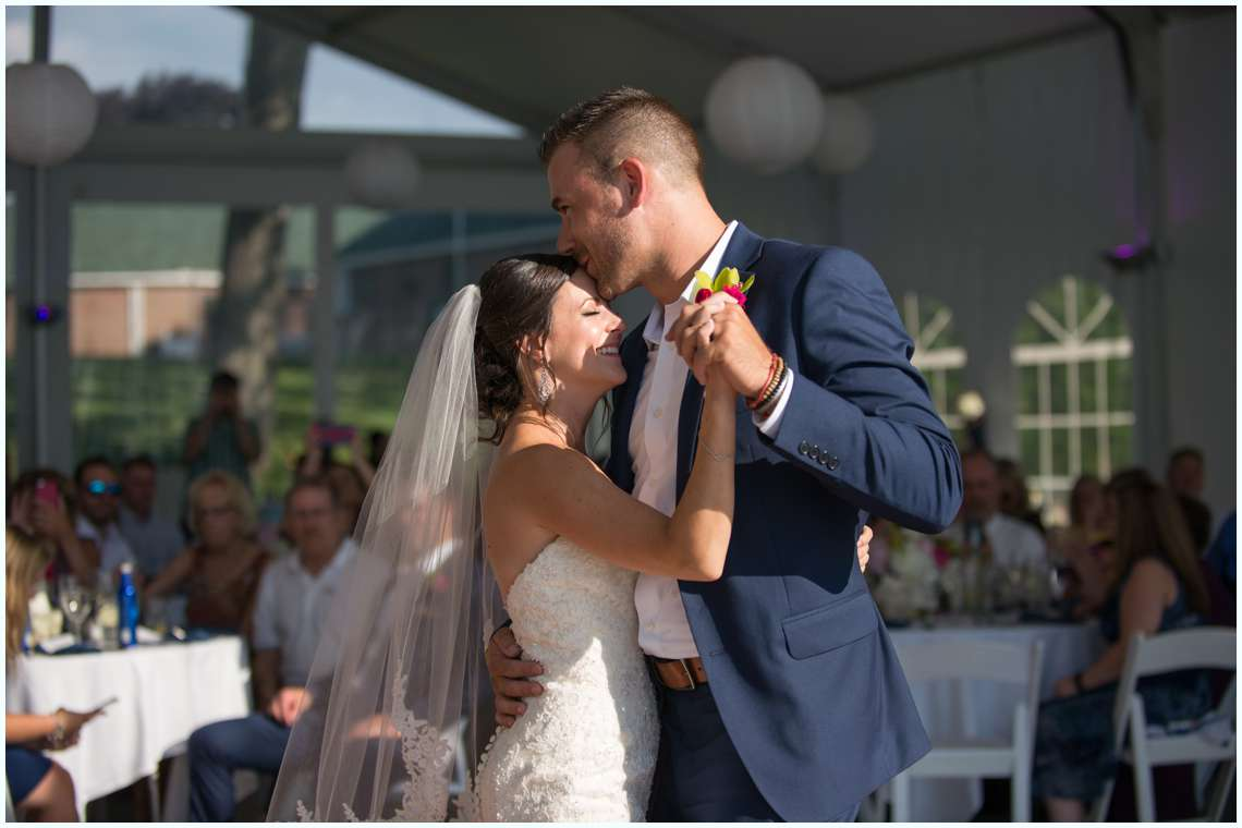 Groom kissing bride during first dance at the Margate Resort