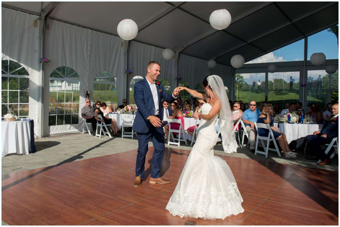 The bride and groom dancing during outside reception