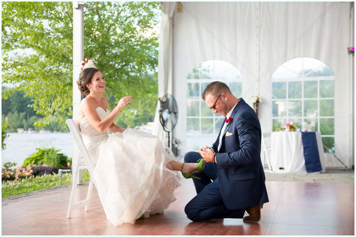 bride laughing at groom during New Hampshire wedding reception