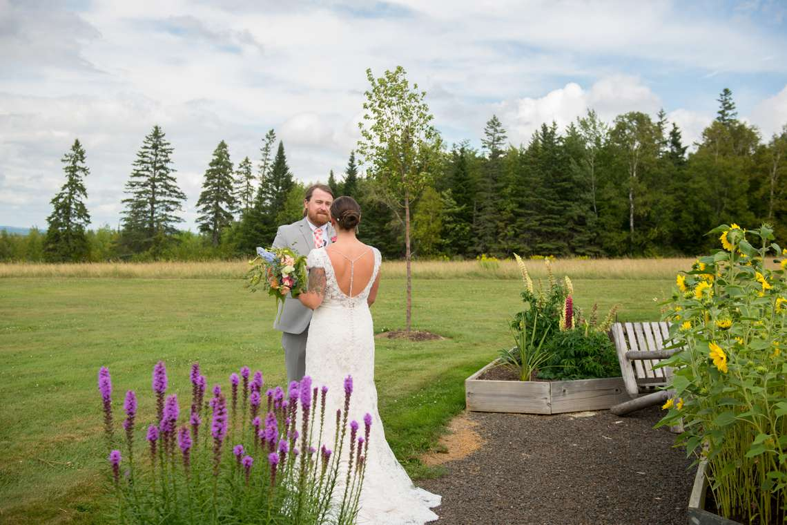 Bride and groom in a garden in Maine