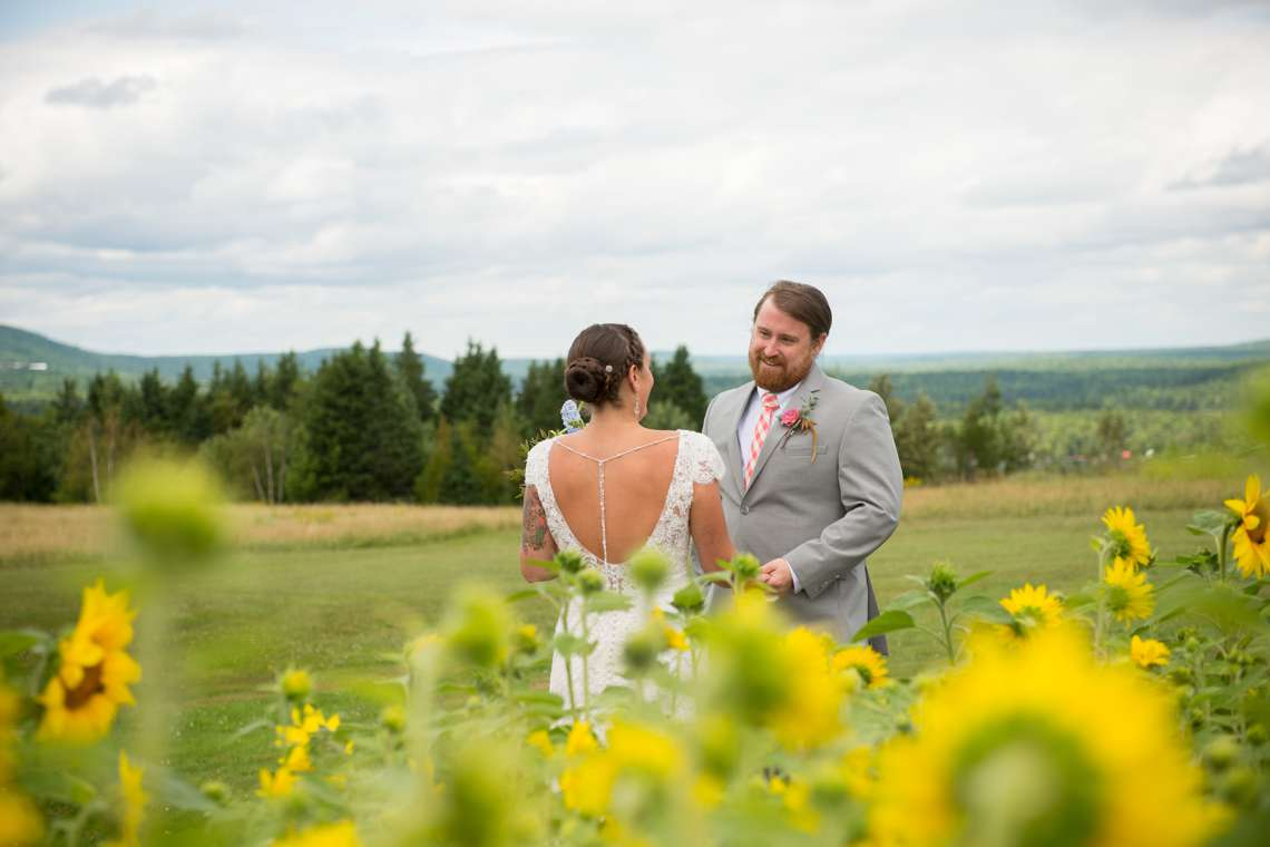 bride and groom in a sunflower field
