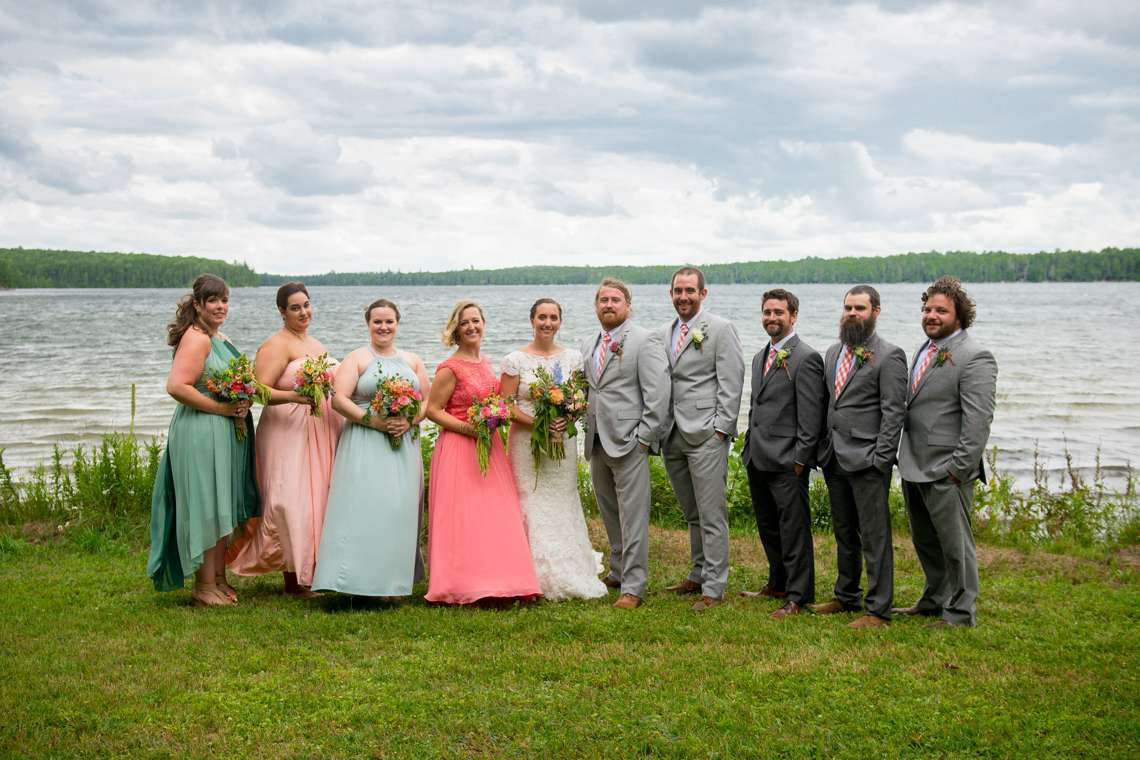 bride and groom with bridal party at a camp wedding