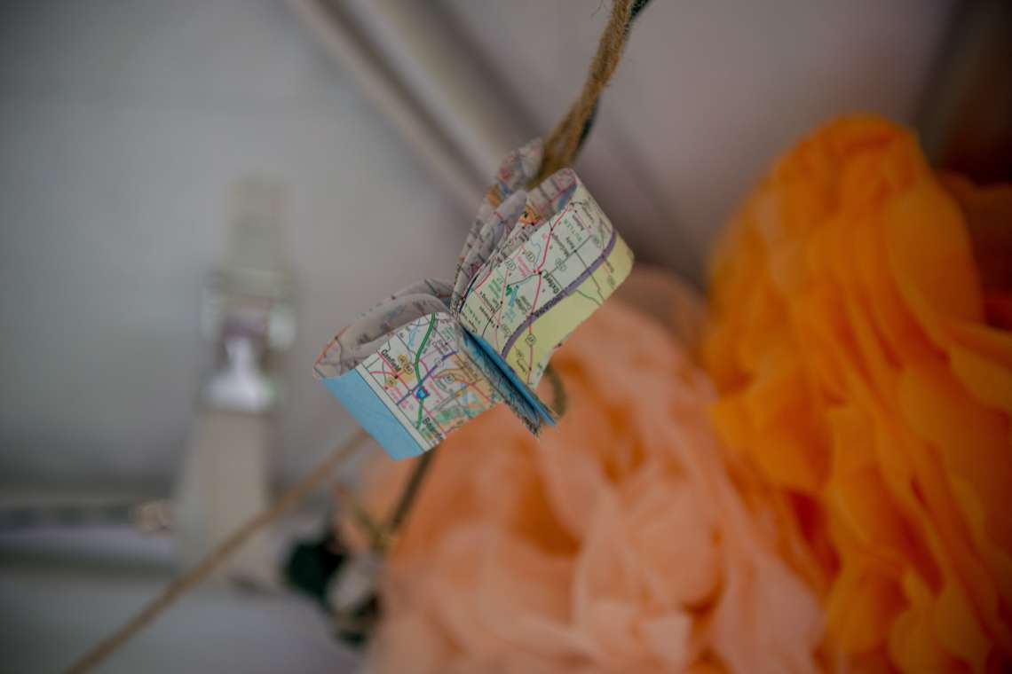 paper hearts made out of maps for wedding decorations