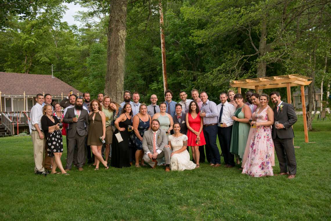 large group photo of bride and groom's friends at camp wedding