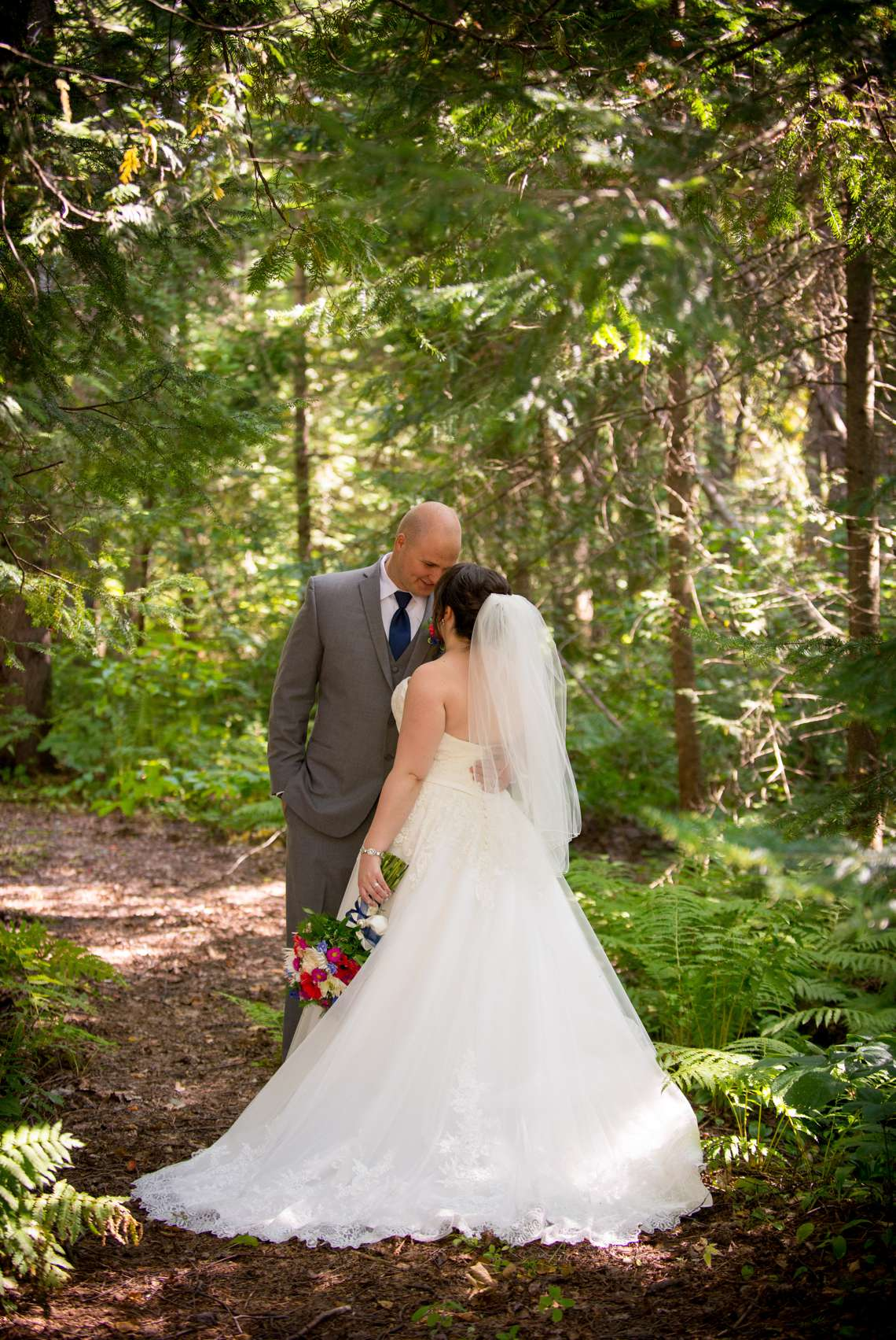 Bride and groom photos on a woods trail