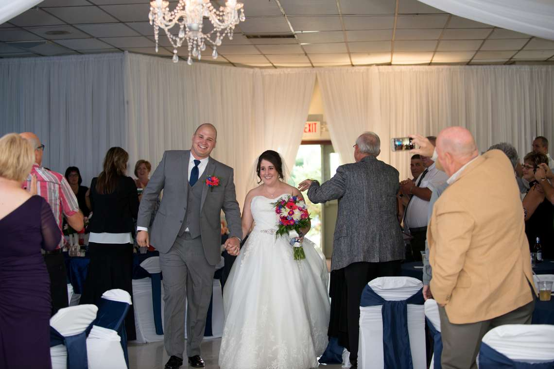 photos of couple entering reception