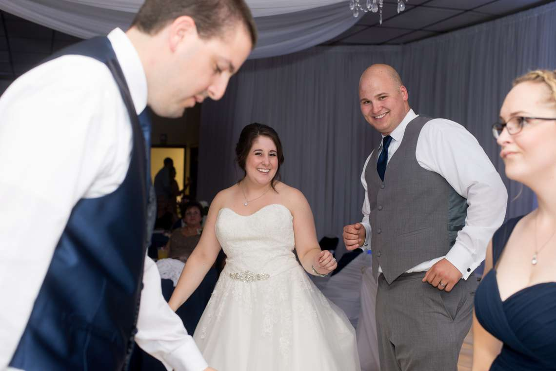 smiling couple dancing during wedding reception