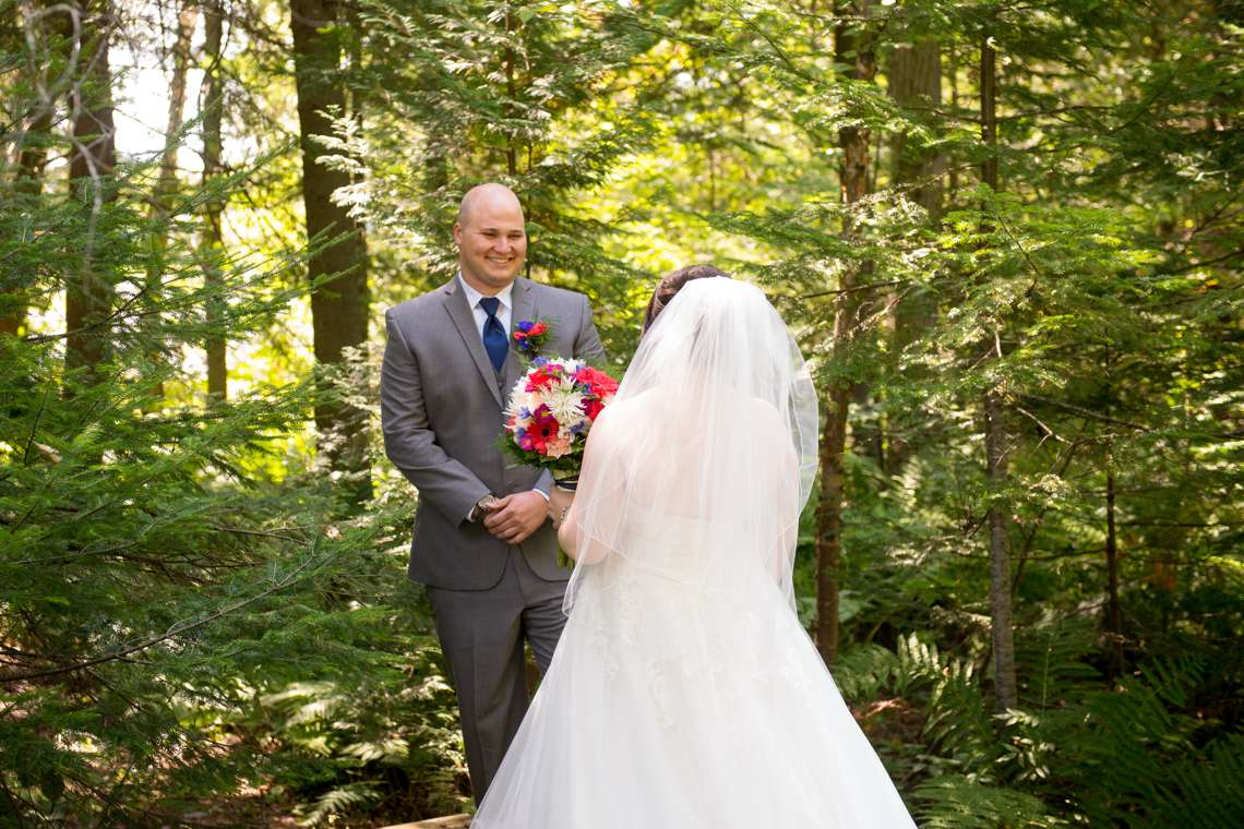 First look on wedding day in the woods