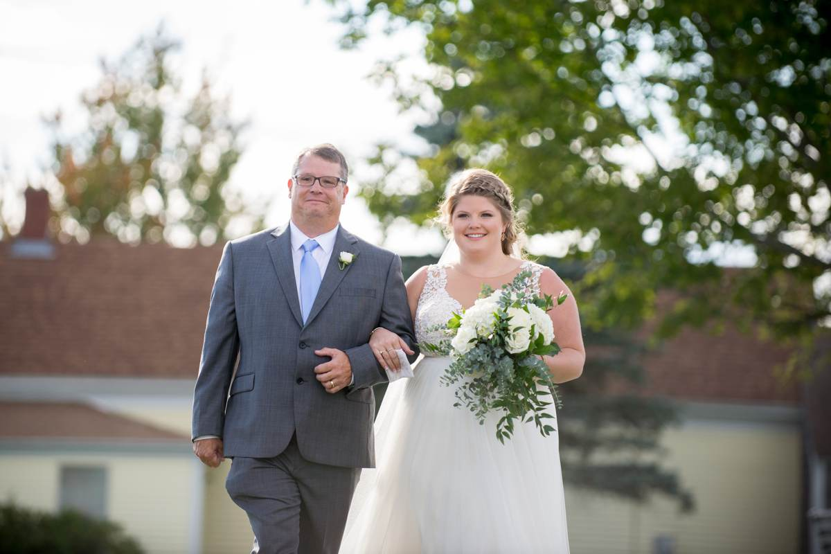 Bride walking with father down the aisle at Vista of Maine Vineyard & Cidery