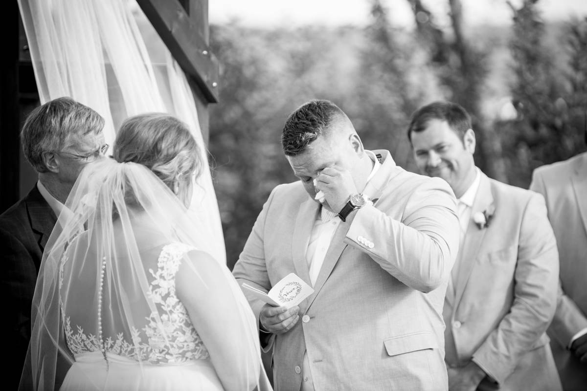 groom crying during wedding ceremony at Vista of Maine Vineyard & Cidery