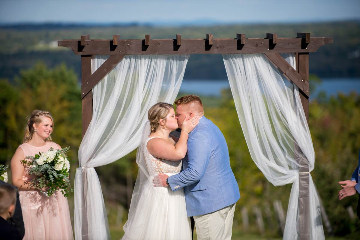 couple kissing during Maine outdoor wedding ceremony