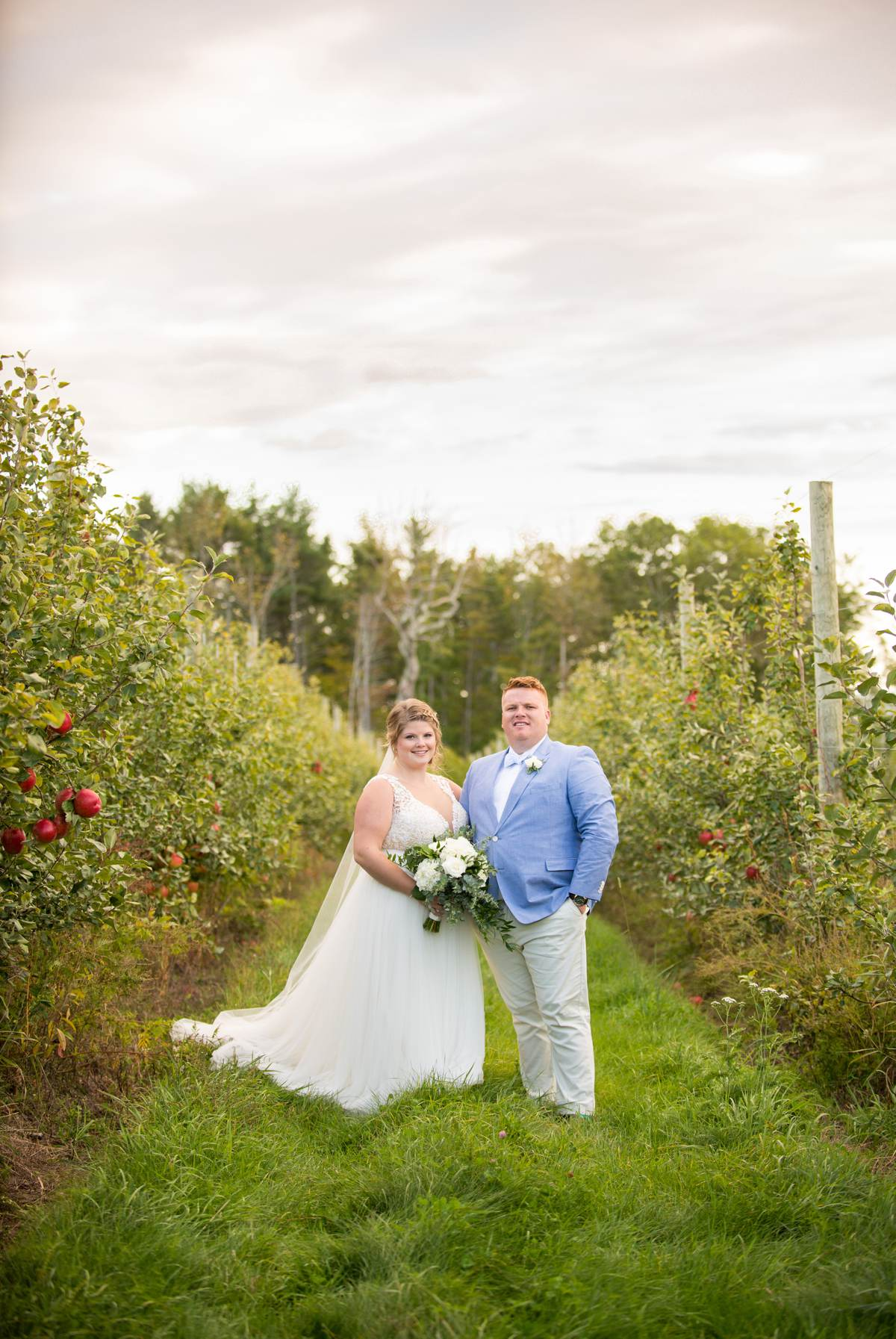 Bride and groom wedding photos in apple orchard