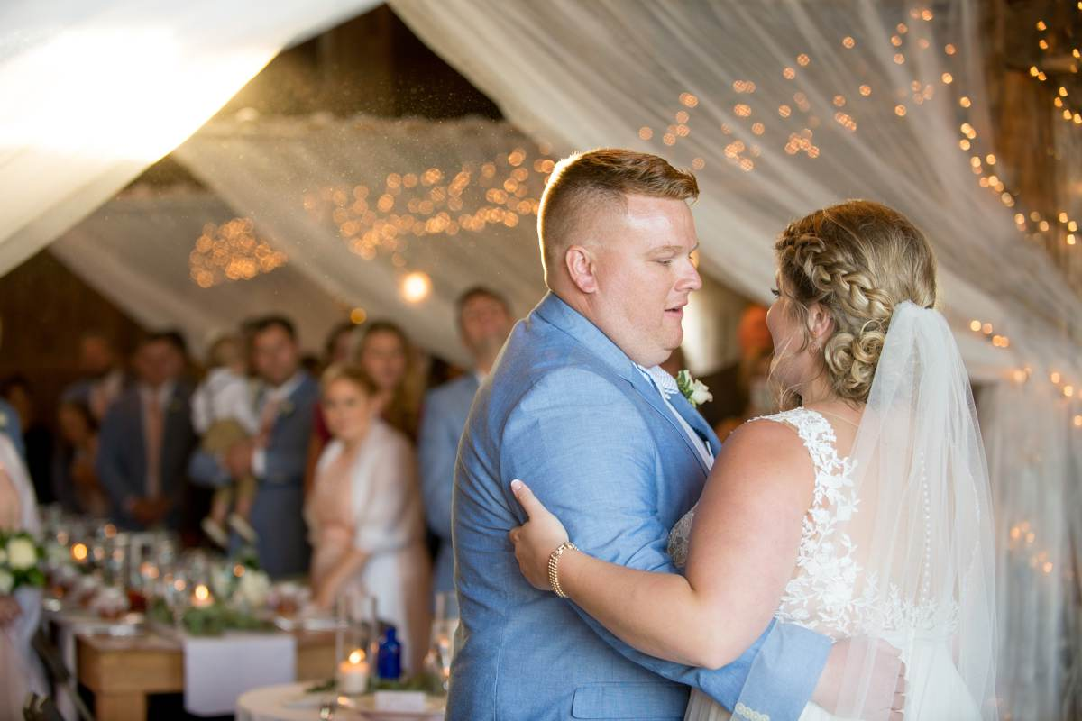 excited couple during first dance in a Maine barn