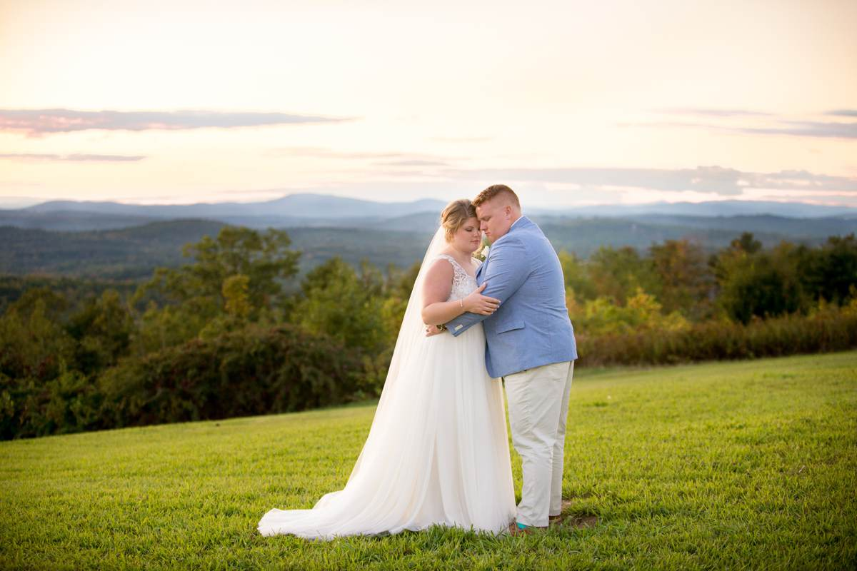 Emotional sunset photos of bride and groom at Maine Vineyard